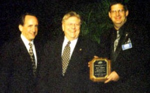 DR. Gene Wilkins receives Man of the Year Award 2003